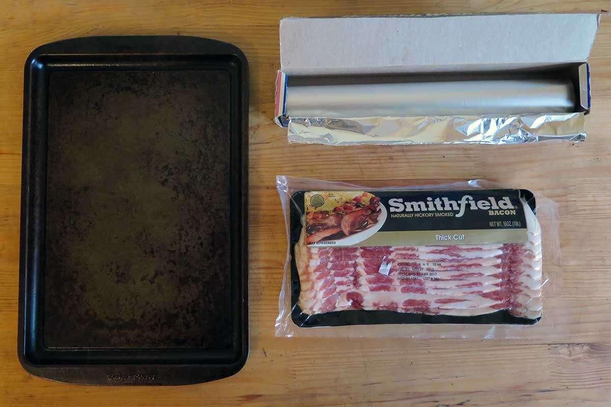 Place The Slices Of Bacon On The Aluminumcovered Baking Sheet It Can Be Any  Kind Of