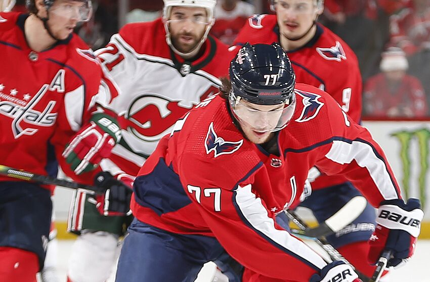 NEWARK, NJ - DECEMBER 20: T.J. Oshie #77 of the Washington Capitals plays the puck against the New Jersey Devils during the game at the Prudential Center on December 20, 2019 in Newark, New Jersey. (Photo by Andy Marlin/NHLI via Getty Images)