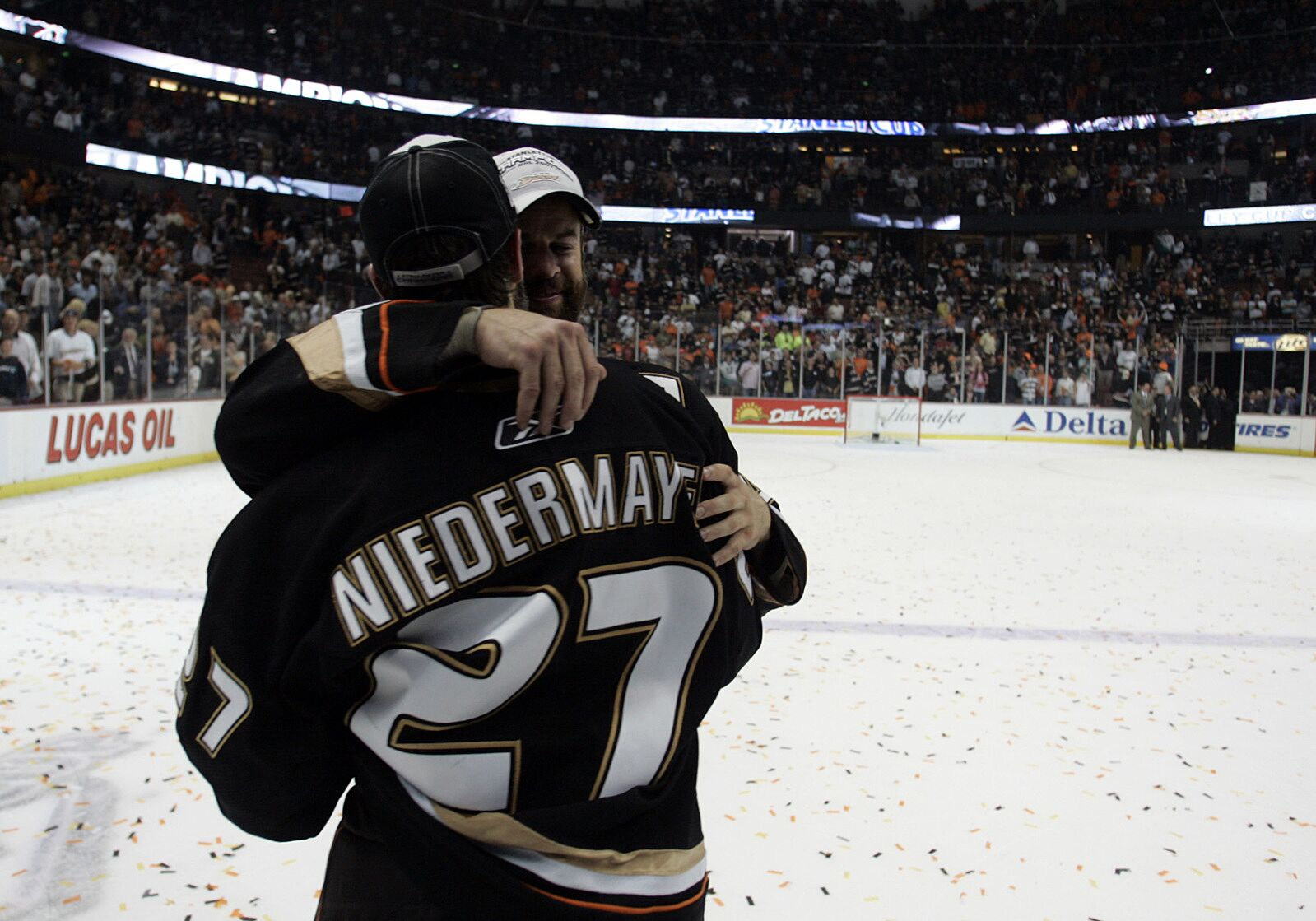 Brothers Scott Niedemayer (27) and Rob embrace after the Anaheim Ducks  became the first West Coast team to win the Stanly Cup after beating the  Ottawa ... 766526549