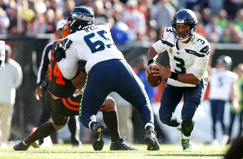 CLEVELAND, OH - OCTOBER 13: Olivier Vernon #54 of the Cleveland Browns is blocked by Germain Ifedi #65 of the Seattle Seahawks allowing Russell Wilson #3 to run for a first down during the fourth quarter at FirstEnergy Stadium on October 13, 2019 in Cleveland, Ohio. Seattle defeated Cleveland 32-28. (Photo by Kirk Irwin/Getty Images)
