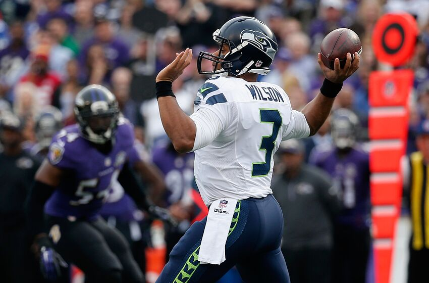 BALTIMORE, MD - DECEMBER 13: Quarterback Russell Wilson #3 of the Seattle Seahawks throws a second half pass against the Baltimore Ravens at M&T Bank Stadium on December 13, 2015 in Baltimore, Maryland. (Photo by Rob Carr/Getty Images)
