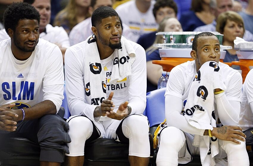 Nov 4, 2015; Indianapolis, IN, USA; From left to right Indiana Pacers forward Solomon HIll, Paul George, and guard Monta Ellis sit on the bench during a game against the Boston Celtics at Bankers Life Fieldhouse. Indiana defeats Boston 100-98. Mandatory Credit: Brian Spurlock-USA TODAY Sports