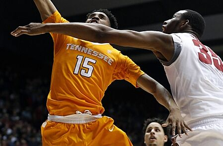 Jan 26, 2016; Tuscaloosa, AL, USA; Tennessee Volunteers guard Detrick Mostella (15) puts up for a shot over Alabama Crimson Tide forward Donta Hall (35) during the first half at Coleman Coliseum. Mandatory Credit: Butch Dill-USA TODAY Sports