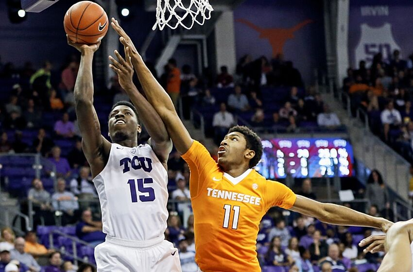 Jan 30, 2016; Fort Worth, TX, USA; TCU Horned Frogs forward JD Miller (15) shoots as Tennessee Volunteers forward Kyle Alexander (11) defends during the first half at Ed and Rae Schollmaier Arena. Mandatory Credit: Kevin Jairaj-USA TODAY Sports