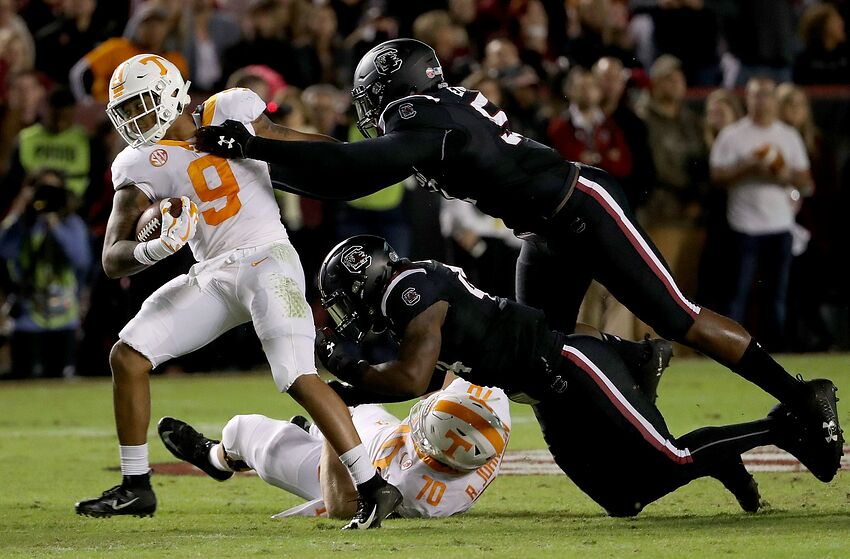 COLUMBIA, SC - OCTOBER 27: Teammates Kingsley Enagbare #52 and Sherrod Greene #44 of the South Carolina Gamecocks try to stop Tim Jordan #9 of the Tennessee Volunteers during their game at Williams-Brice Stadium on October 27, 2018 in Columbia, South Carolina. (Photo by Streeter Lecka/Getty Images)