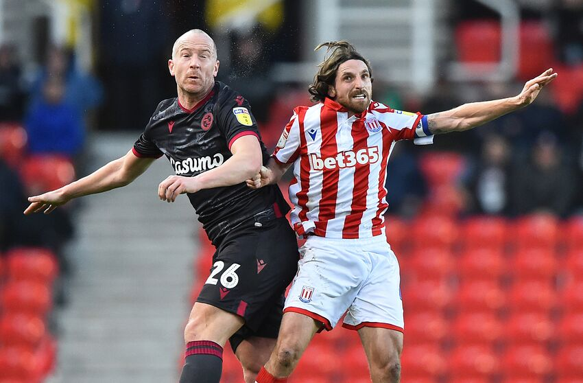 STOKE ON TRENT, ENGLAND - DECEMBER 14: Joe Allen of Stoke City and Charlie Adam of Reading compete for the ball during the Sky Bet Championship match between Stoke City and Reading at Bet365 Stadium on December 14, 2019 in Stoke on Trent, England. (Photo by Nathan Stirk/Getty Images)