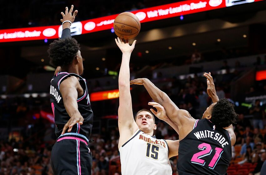 Nikola Jokic #15 of the Denver Nuggets shoots over Josh Richardson #0 and Hassan Whiteside #21 (Photo by Michael Reaves/Getty Images)