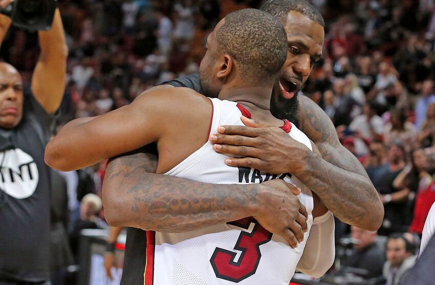 5cac6365aed The Miami Heat s Dwyane Wade (3) and the Cleveland Cavaliers  LeBron James  hug