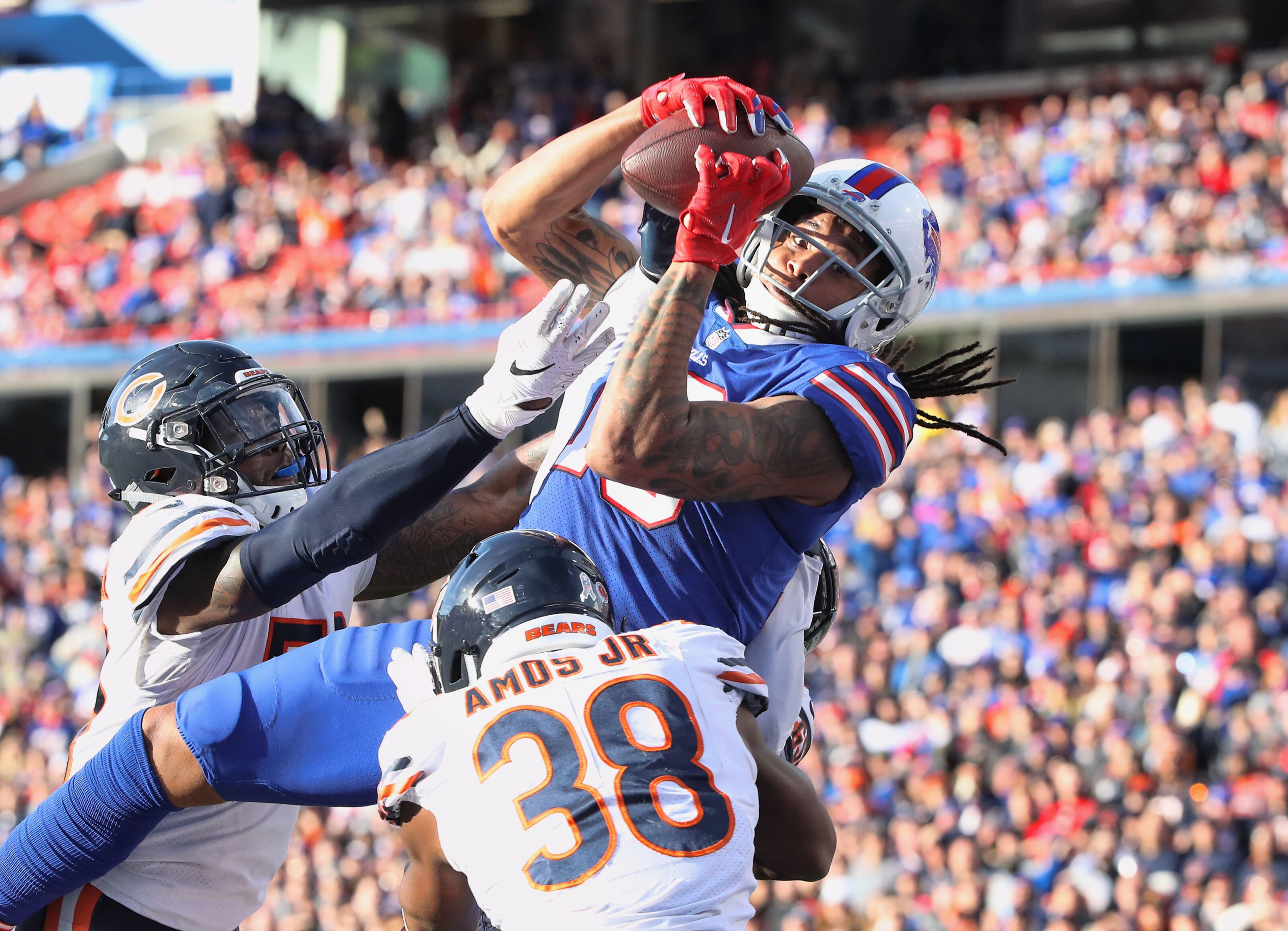 BUFFALO, NY - NOVEMBER 04: Kelvin Benjamin #13 of the Buffalo Bills cannot hang on to a pass in the end zone as he drops the ball in the third quarter during NFL game action as he is hit by Adrian Amos Jr. #38 of the Chicago Bears at New Era Field on November 4, 2018 in Buffalo, New York. (Photo by Tom Szczerbowski/Getty Images)