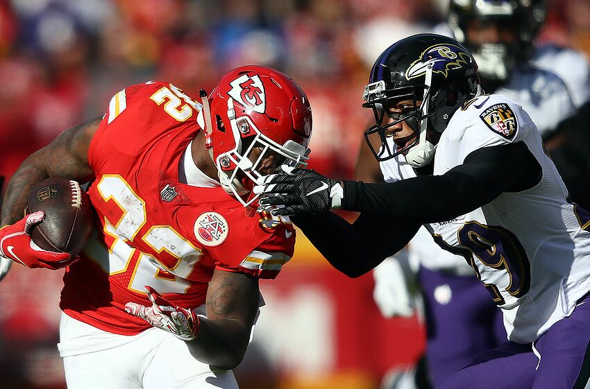 KANSAS CITY, MISSOURI - DECEMBER 09: Running back Spencer Ware #32 of the Kansas City Chiefs carries the ball as cornerback Marlon Humphrey #29 of the Baltimore Ravens defends during the game at Arrowhead Stadium on December 09, 2018 in Kansas City, Missouri. (Photo by Jamie Squire/Getty Images)