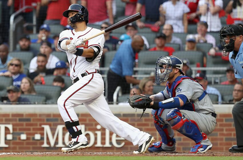 ATLANTA, GA - OCTOBER 08: Pinch hitter Kurt Suzuki #24 of the Atlanta Braves hits a two run RBI single during the fourth inning of Game Four of the National League Division Series against the Los Angeles Dodgers at Turner Field on October 8, 2018 in Atlanta, Georgia. (Photo by Rob Carr/Getty Images)