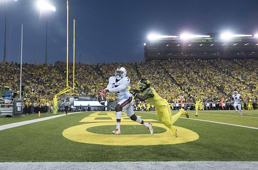 Sep 10, 2016; Eugene, OR, USA; Virginia Cavaliers wide receiver Doni Dowling (7) and Oregon Ducks defensive back Arrion Springs (1) dive for the ball in the first quarter at Autzen Stadium. Mandatory Credit: Cole Elsasser-USA TODAY Sports