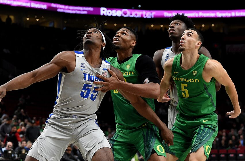 PORTLAND, OREGON - NOVEMBER 12: Precious Achiuwa #55 of the Memphis Tigers, Francis Okoro #33 of the Oregon Ducks, James Wiseman #32 of the Memphis Tigers and Chris Duarte #5 of the Oregon Ducks battle for position during the first half of the game between the Oregon Ducks and Memphis Grizzlies at Moda Center on November 12, 2019 in Portland, Oregon. (Photo by Steve Dykes/Getty Images)