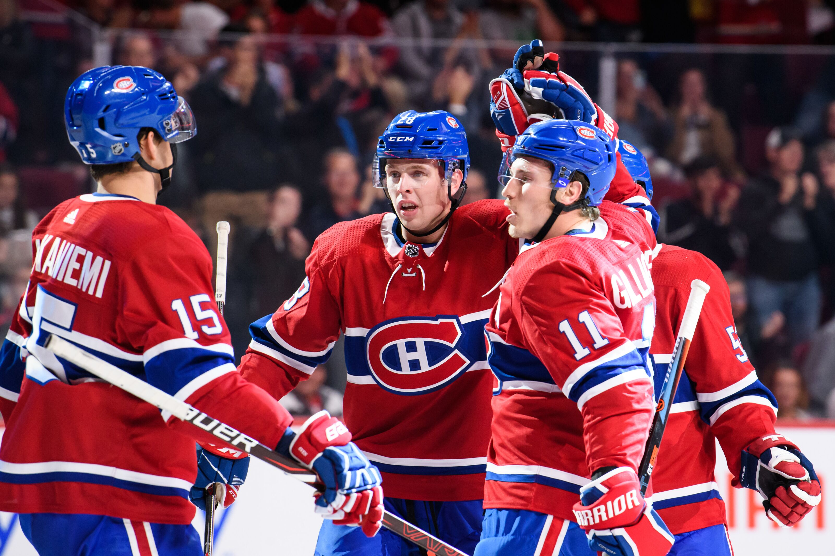 MONTREAL, QC - SEPTEMBER 26: Montreal Canadiens right wing Brendan Gallagher (11) celebrates with teammates Mike Reilly (28) and Jesperi Kotkaniemi (15) during the second period of the NHL preseason game between the Toronto Maple Leafs and the Montreal Canadiens on September 26, 2018, at the Bell Centre in Montreal, QC (Photo by Vincent Ethier/Icon Sportswire via Getty Images)