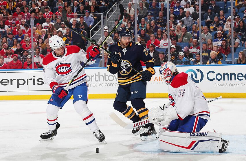 BUFFALO, NY - OCTOBER 9: Ben Chiarot #8 and Keith Kinkaid #37 of the Montreal Canadiens defend the net against Sam Reinhart #23 of the Buffalo Sabres during an NHL game on October 9, 2019 at KeyBank Center in Buffalo, New York. (Photo by Bill Wippert/NHLI via Getty Images)