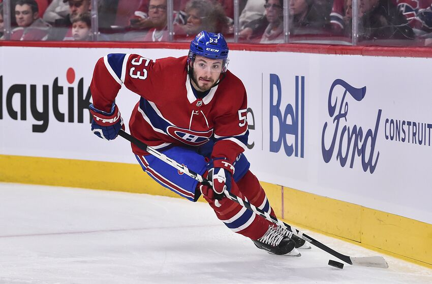 MONTREAL, QC - JANUARY 02: Victor Mete #53 of the Montreal Canadiens skates the puck against the Tampa Bay Lightning during the first period at the Bell Centre on January 2, 2020 in Montreal, Canada. The Tampa Bay Lightning defeated the Montreal Canadiens 2-1. (Photo by Minas Panagiotakis/Getty Images)