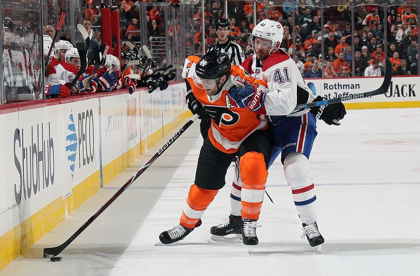 PHILADELPHIA, PA - FEBRUARY 20: Andrew MacDonald #47 of the Philadelphia Flyers keeps possession of the puck along the boards while battling with Paul Byron #41 of the Montreal Canadiens on February 20, 2018 at the Wells Fargo Center in Philadelphia, Pennsylvania. (Photo by Len Redkoles/NHLI via Getty Images)