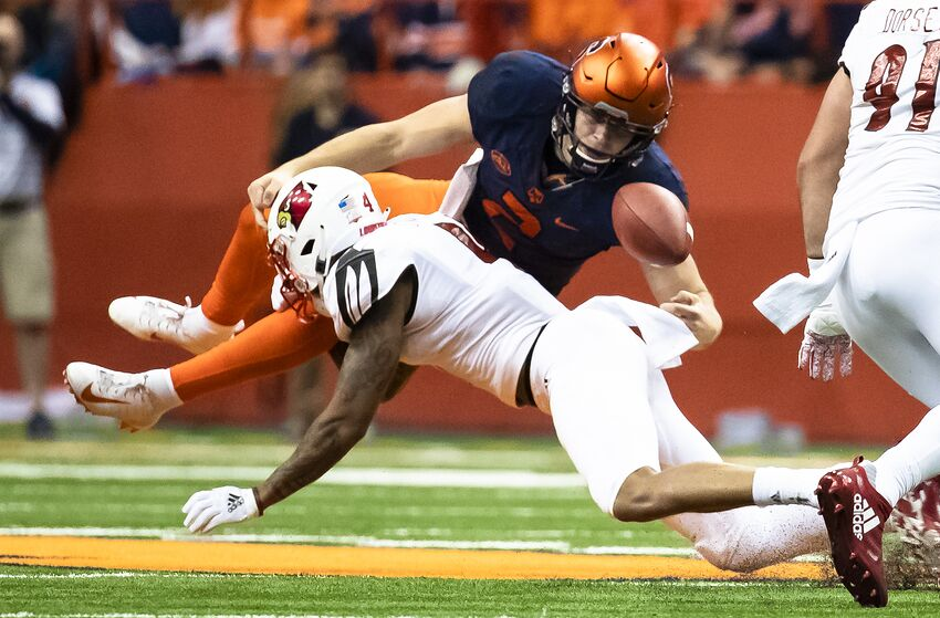 SYRACUSE, NY - NOVEMBER 09: Eric Dungey #2 of the Syracuse Orange fumbles but retains possession after being hit by TreSean Smith #4 of the Louisville Cardinals during a run in the third quarter at the Carrier Dome on November 9, 2018 in Syracuse, New York. (Photo by Brett Carlsen/Getty Images)