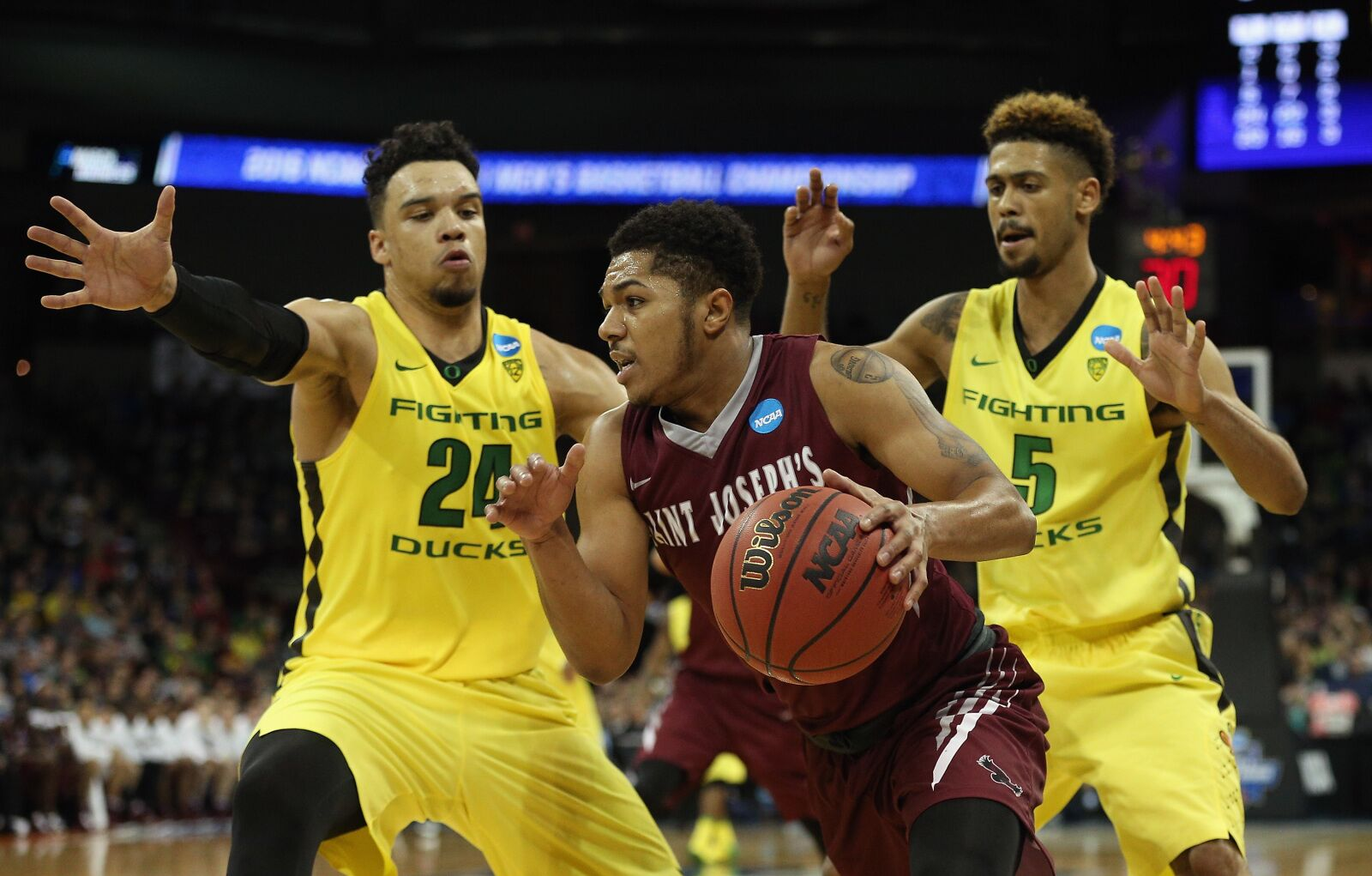 SPOKANE, WA - MARCH 20: Lamarr Kimble #0 of the Saint Joseph's Hawks drives against Dillon Brooks #24 and Tyler Dorsey #5 of the Oregon Ducks in the second half during the second round of the 2016 NCAA Men's Basketball Tournament at Spokane Veterans Memorial Arena on March 20, 2016 in Spokane, Washington. (Photo by Patrick Smith/Getty Images)
