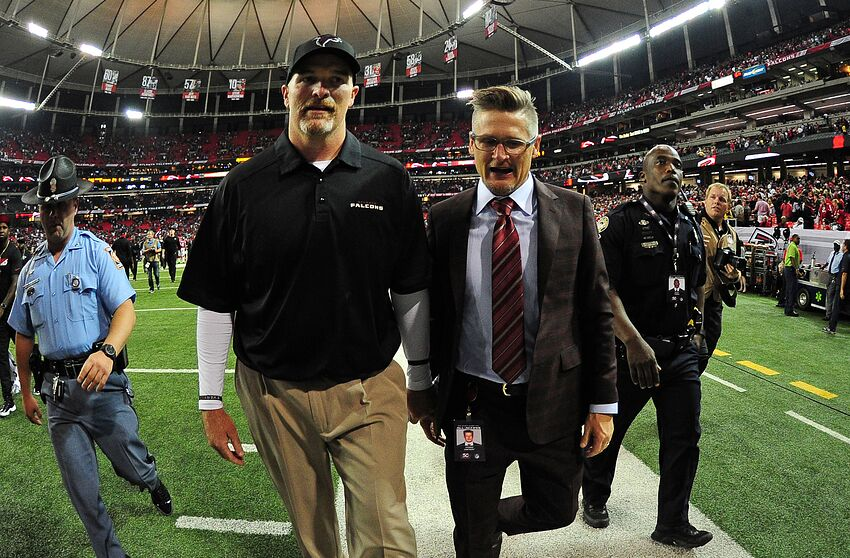 ATLANTA, GA - SEPTEMBER 14: Head Coach Dan Quinn and General Manager Thomas Dimitroff of the Atlanta Falcons head off the field after the game against the Philadelphia Eagles at the Georgia Dome on September 14, 2015 in Atlanta, Georgia. (Photo by Scott Cunningham/Getty Images)