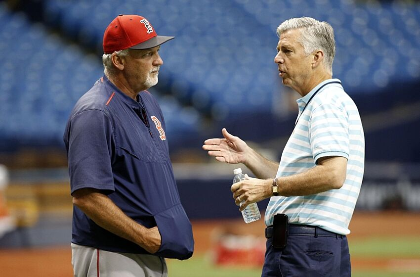 Jun 28, 2016; St. Petersburg, FL, USA; Boston Red Sox pitching coach Carl Willis (54) talks with president of baseball operations Dave Dombrowski prior to the game against the Tampa Bay Rays at Tropicana Field. Mandatory Credit: Kim Klement-USA TODAY Sports