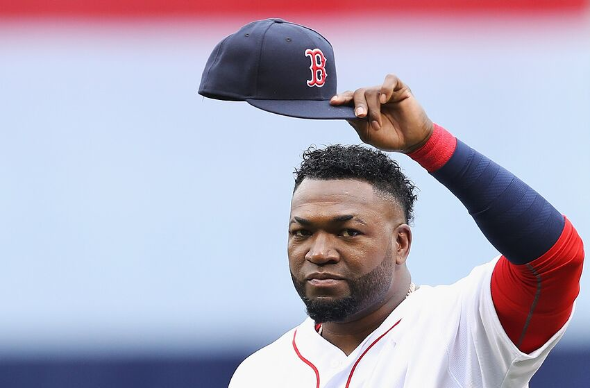 BOSTON, MA - OCTOBER 02: David Ortiz #34 of the Boston Red Sox tips his cap to fans during the pregame ceremony to honor his retirement before his last regular season home game at Fenway Park on October 2, 2016 in Boston, Massachusetts. (Photo by Maddie Meyer/Getty Images)