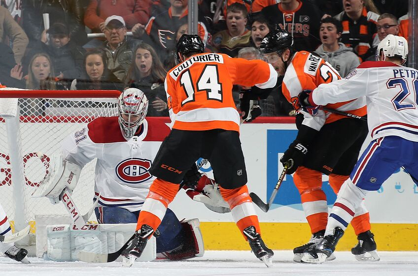 PHILADELPHIA, PA - MARCH 19: Sean Couturier #14 of the Philadelphia Flyers scores a third period goal on this shot against Carey Price #31 of the Montreal Canadiens on March 19, 2019 at the Wells Fargo Center in Philadelphia, Pennsylvania. (Photo by Len Redkoles/NHLI via Getty Images)