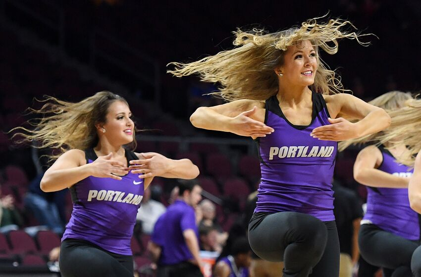LAS VEGAS, NV - MARCH 04: Portland Pilots cheerleaders perform during the team's quarterfinal game of the West Coast Conference Basketball Tournament against the Saint Mary's Gaels at the Orleans Arena on March 4, 2017 in Las Vegas, Nevada. Saint Mary's won 81-58. (Photo by Ethan Miller/Getty Images)