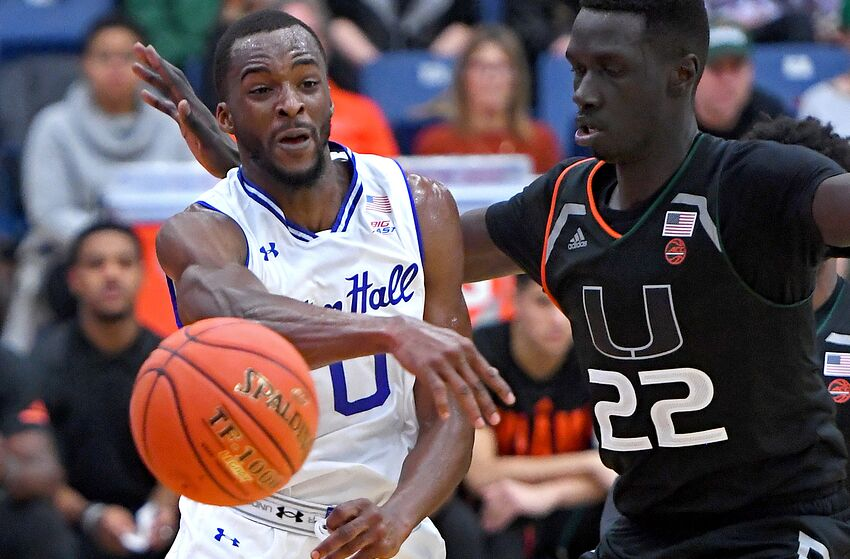 FULLERTON, CA - NOVEMBER 25: Deng Gak #22 of the Miami Hurricanes guards Quincy McKnight #0 of the Seton Hall Pirates as he makes a pass under the basket in the first half of the game game during the Wooden Legacy Tournament at Titan Gym on November 25, 2018 in Fullerton, California. (Photo by Jayne Kamin-Oncea/Getty Images)