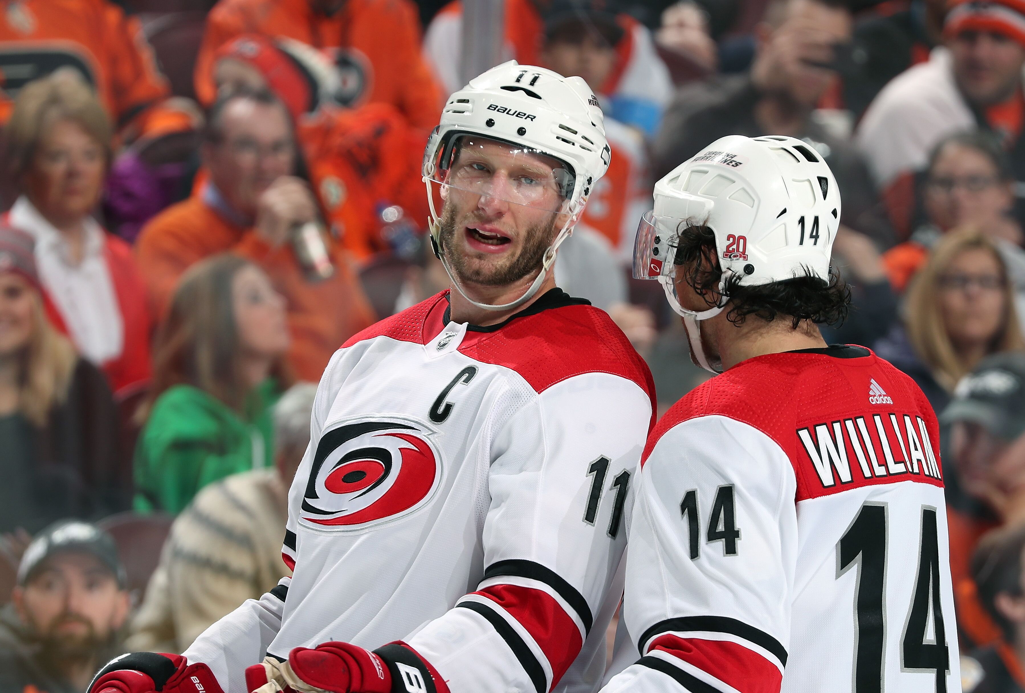PHILADELPHIA, PA - MARCH 01: Jordan Staal #11 and Justin Williams #14 of the Carolina Hurricanes chat during a stoppage in play against the Philadelphia Flyers on March 1, 2018 at the Wells Fargo Center in Philadelphia, Pennsylvania. (Photo by Len Redkoles/NHLI via Getty Images)