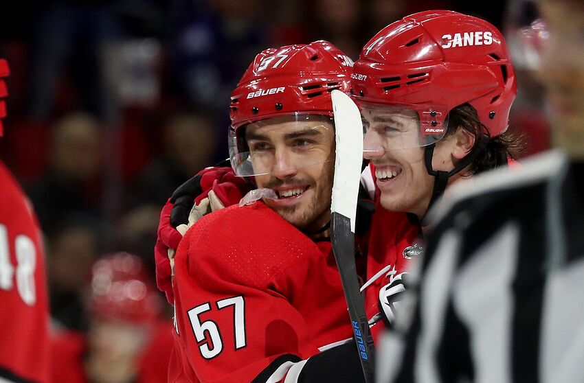 RALEIGH, NC - NOVEMBER 21: Trevor van Riemsdyk #57 of the Carolina Hurricanes celebrates with teammate Haydn Fleury #4 after scoring a goal during an NHL game against the Toronto Maple Leafs on November 21, 2018 at PNC Arena in Raleigh, North Carolina. (Photo by Gregg Forwerck/NHLI via Getty Images)