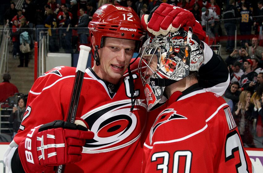 RALEIGH, NC - JANUARY 24: Eric Staal #12 of the Carolina Hurricanes congratulates Cam Ward #30 following a victory over the Buffalo Sabres during an NHL game at PNC Arena on January 24, 2013. (Photo by Gregg Forwerck/NHLI via Getty Images)