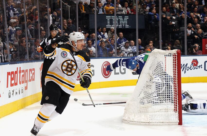 TORONTO, ONTARIO - NOVEMBER 15: Skating in his 700th NHL game, Brad Marchand #63 of the Boston Bruins scores the game winning goal at 5:08 of the third period against the Toronto Maple Leafs at the Scotiabank Arena on November 15, 2019 in Toronto, Ontario, Canada. The Bruins defeated the Maple Leafs 4-2. (Photo by Bruce Bennett/Getty Images)