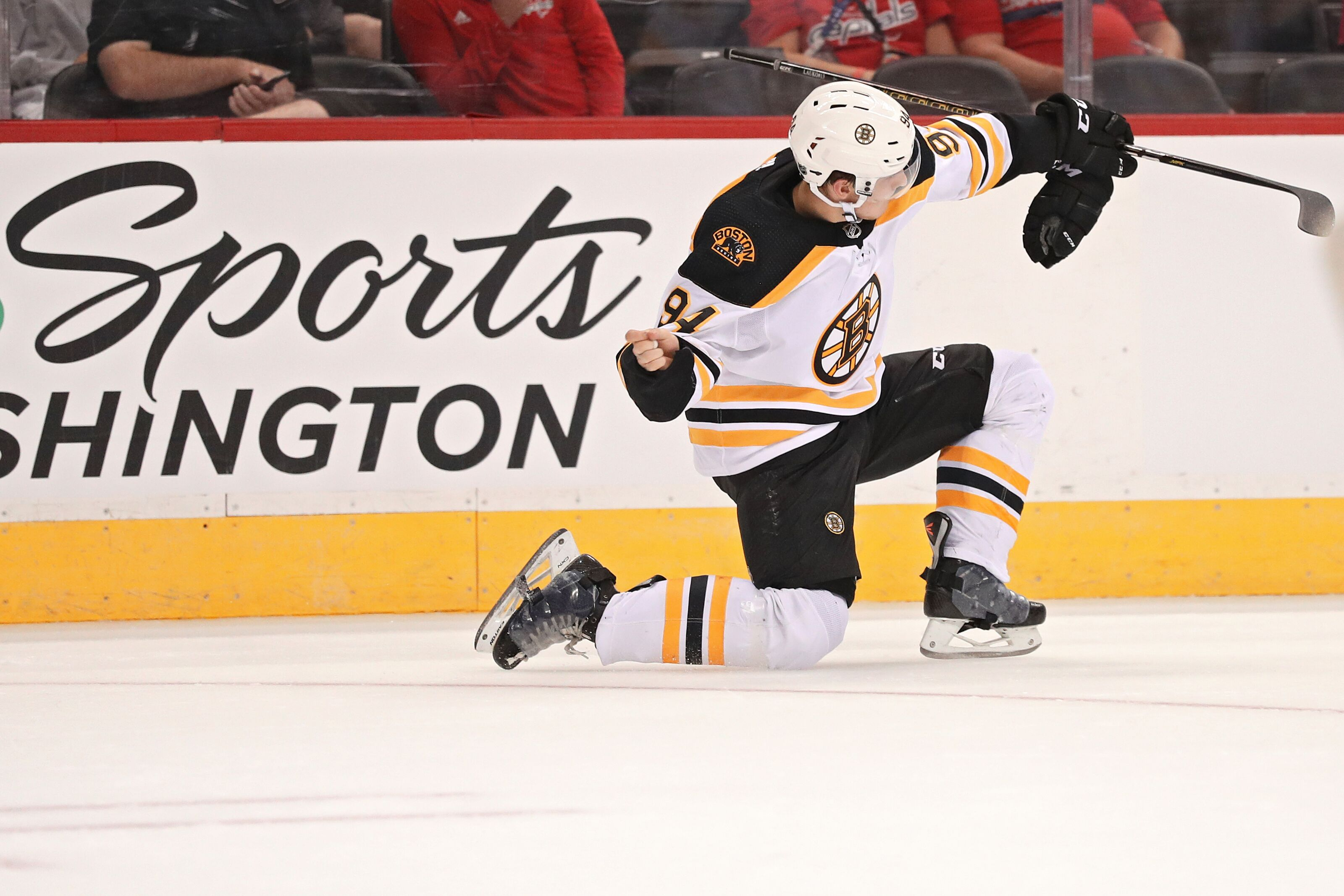 WASHINGTON, DC - SEPTEMBER 18: Jakub Lauko #94 of the Boston Bruins celebrates after scoring a goal against the Washington Capitals during the first period of a preseason NHL game at Capital One Arena on September 18, 2018 in Washington, DC. (Photo by Patrick Smith/Getty Images)