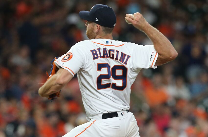 HOUSTON, TEXAS - AUGUST 03: Joe Biagini #29 of the Houston Astros pitches in the eighth inning against the Seattle Mariners at Minute Maid Park on August 03, 2019 in Houston, Texas. (Photo by Bob Levey/Getty Images)