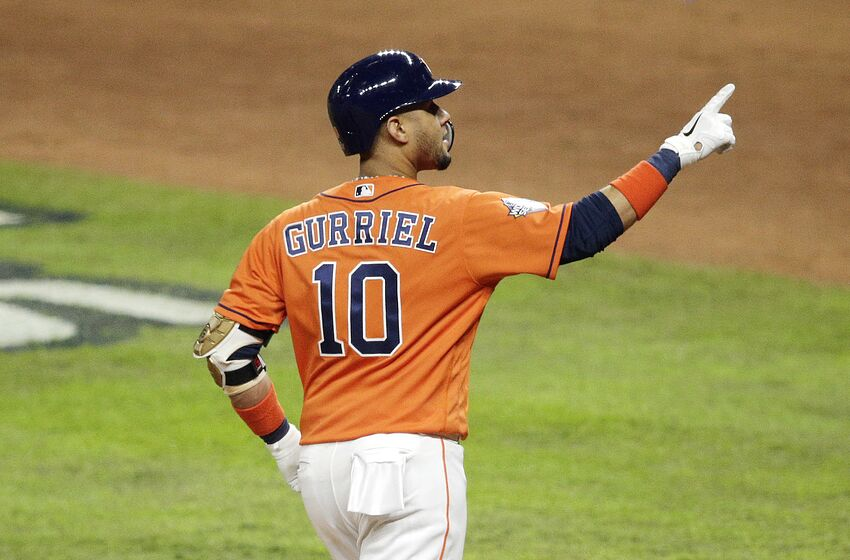 HOUSTON, TEXAS - OCTOBER 30: Yuli Gurriel #10 of the Houston Astros celebrates his solo home run against the Washington Nationals during the second inning in Game Seven of the 2019 World Series at Minute Maid Park on October 30, 2019 in Houston, Texas. (Photo by Bob Levey/Getty Images)