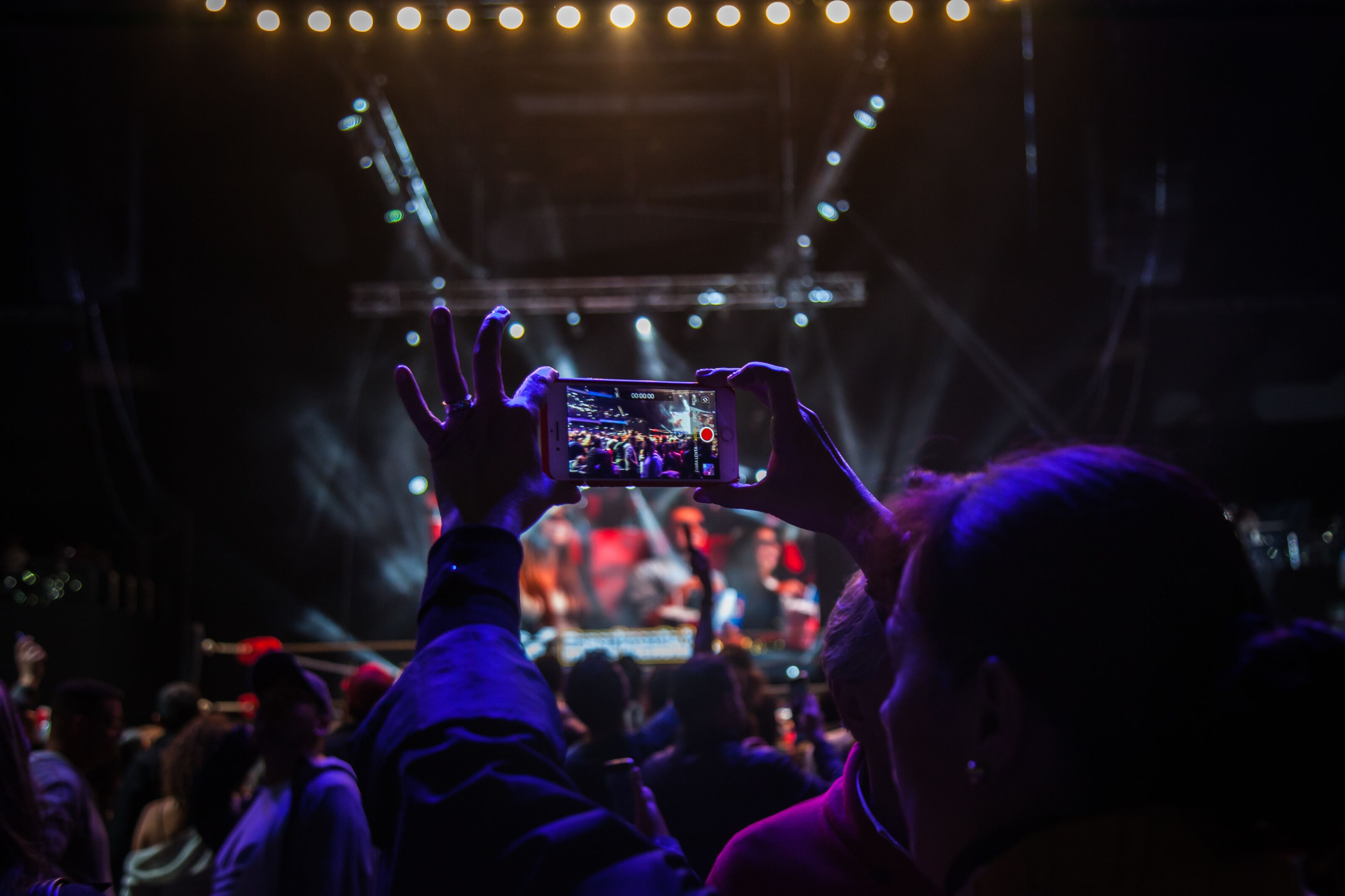 BOGOTA, COLOMBIA - NOVEMBER 16: A fan taking a picture with her phone during an AAA World Wide Wrestling match on November 16, 2018 in Bogota, Colombia. (Photo by Juancho Torres/Getty Images)