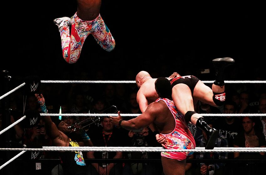 MUNICH, GERMANY - NOVEMBER 03: Kofi Kingston of The New Day jumps off the top rope to win the tag team match during the WWE Live Munich event at Olympiahalle on November 3, 2016 in Munich, Germany. (Photo by Adam Pretty/Bongarts/Getty Images)