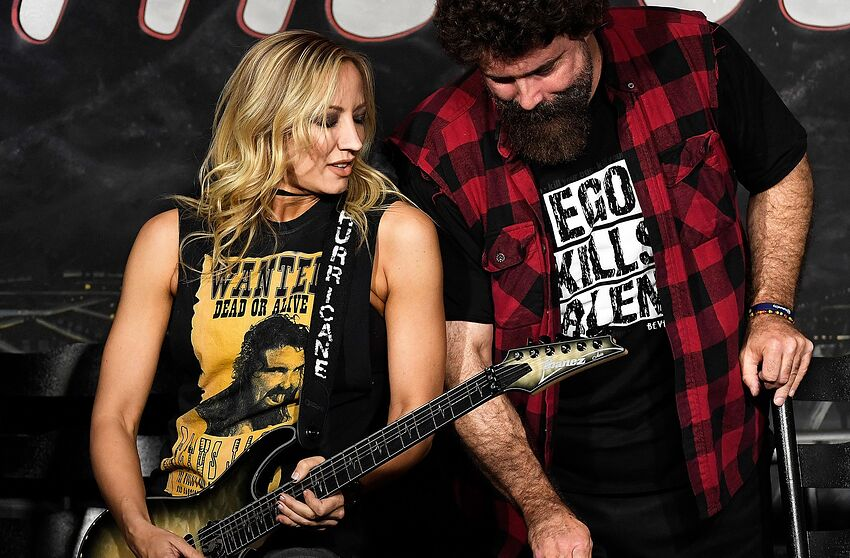 PASADENA, CA - MAY 03: Guitarist Nita Strauss (L) and wrestler Mick Foley perform during their appearance at The Ice House Comedy Club on May 3, 2018 in Pasadena, California. (Photo by Michael S. Schwartz/Getty Images)