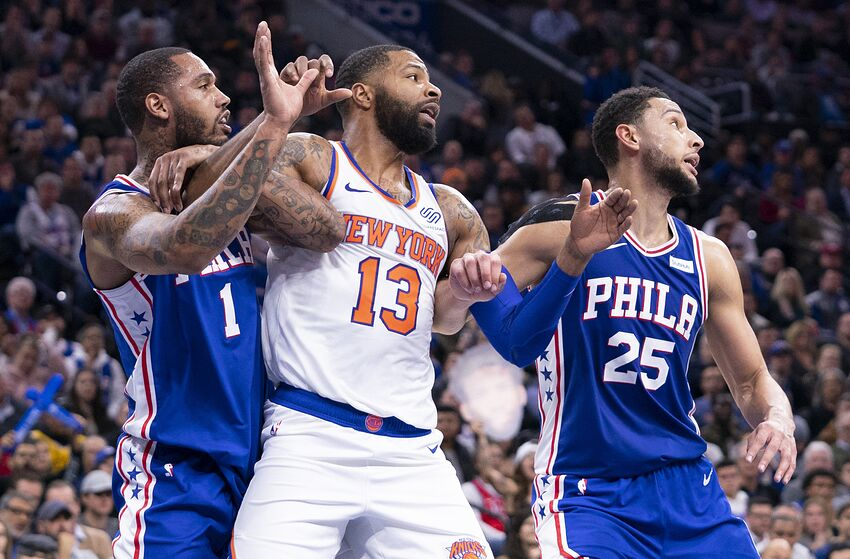 PHILADELPHIA, PA - NOVEMBER 20: Mike Scott #1 and Ben Simmons #25 of the Philadelphia 76ers box out Marcus Morris Sr. #13 of the New York Knicks at the Wells Fargo Center on November 20, 2019 in Philadelphia, Pennsylvania. NOTE TO USER: User expressly acknowledges and agrees that, by downloading and/or using this photograph, user is consenting to the terms and conditions of the Getty Images License Agreement. (Photo by Mitchell Leff/Getty Images)