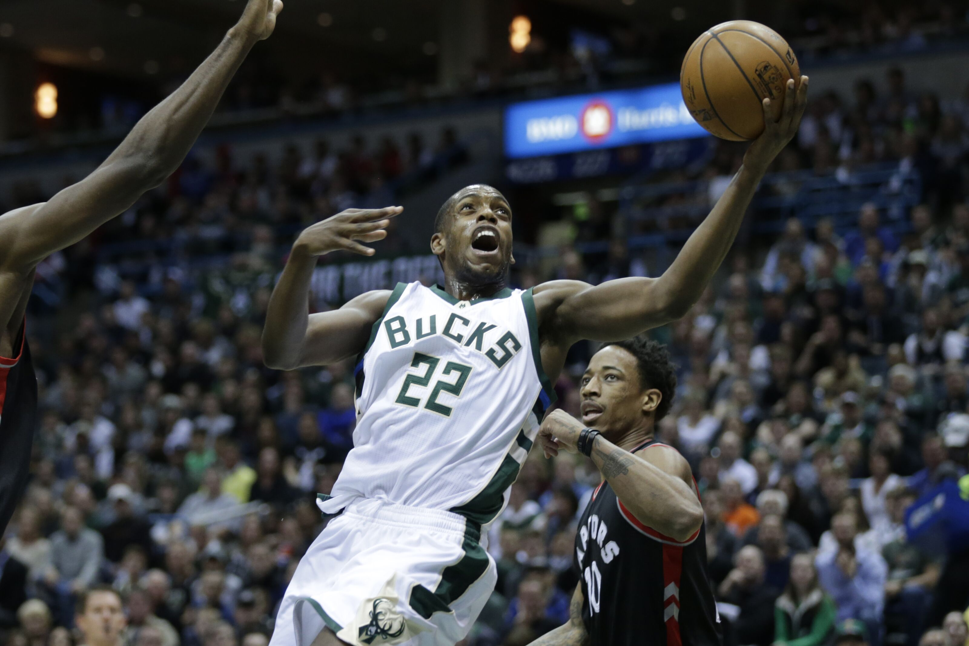 MILWAUKEE, WI - APRIL 22: Khris Middleton #22 of the Milwaukee Bucks drives to the hoop during the first half against the Toronto Raptors of Game Four of the Eastern Conference Quarterfinals during the 2017 NBA Playoffs at the BMO Harris Bradley Center on April 22, 2017 in Milwaukee, Wisconsin. NOTE TO USER: User expressly acknowledges and agrees that, by downloading and or using the photograph, User is consenting to the terms and conditions of the Getty Images License Agreement. (Photo by Mike McGinnis/Getty Images)