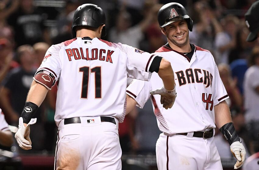 PHOENIX, AZ - SEPTEMBER 26: A.J. Pollock #11 of the Arizona Diamondbacks is congratulated by Paul Goldschmidt #44 after hitting a three-run home run during the fifth inning of the MLB game against the Los Angeles Dodgers at Chase Field on September 26, 2018 in Phoenix, Arizona. (Photo by Jennifer Stewart/Getty Images)