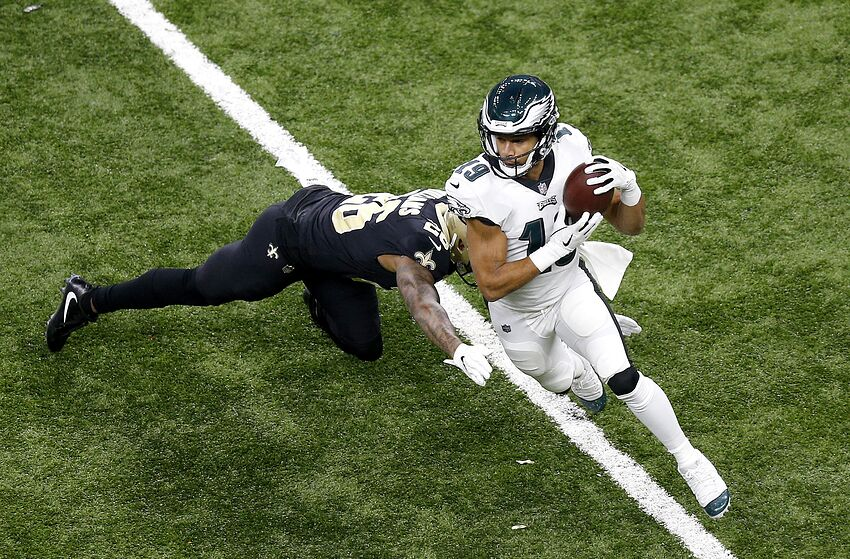 NEW ORLEANS, LOUISIANA - JANUARY 13: Golden Tate #19 of the Philadelphia Eagles avoids the tackle attempt of P.J. Williams #26 of the New Orleans Saints during the first quarter in the NFC Divisional Playoff Game at Mercedes Benz Superdome on January 13, 2019 in New Orleans, Louisiana. (Photo by Jonathan Bachman/Getty Images)