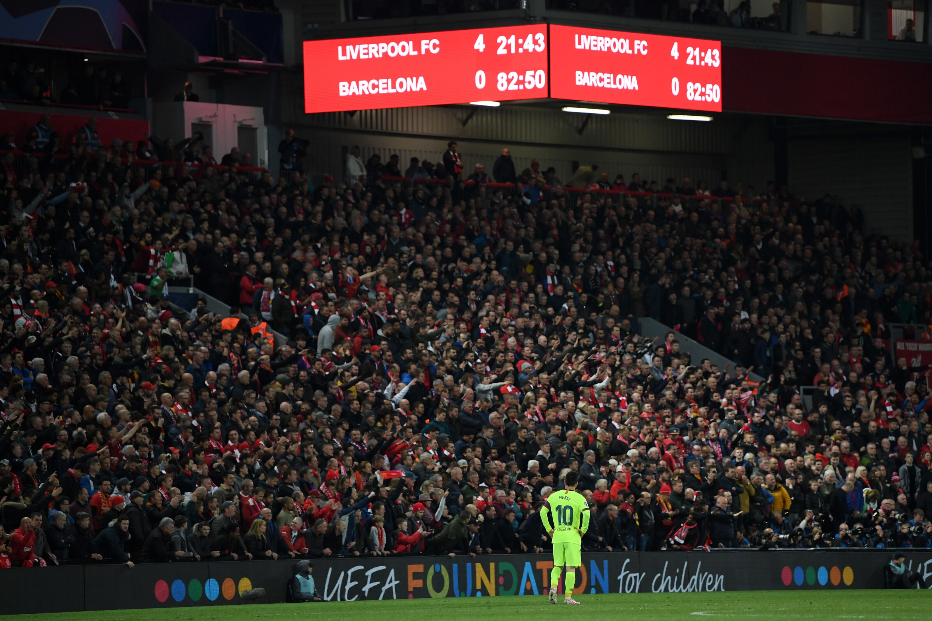 LIVERPOOL, ENGLAND - MAY 07: Lionel Messi of Barcelona looks dejected as the scoreboard reads '4-0' during the UEFA Champions League Semi Final second leg match between Liverpool and Barcelona at Anfield on May 07, 2019 in Liverpool, England. (Photo by Shaun Botterill/Getty Images)
