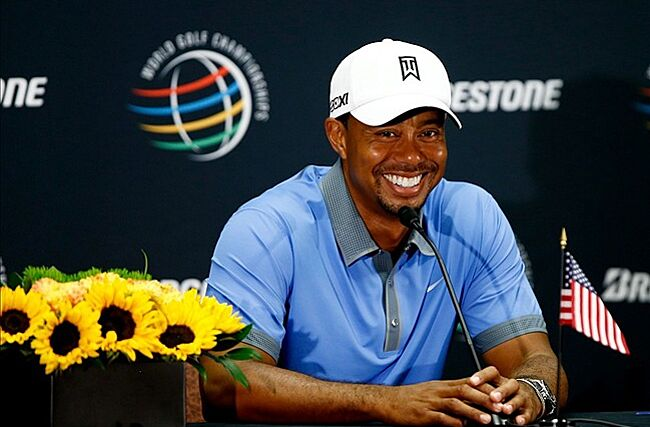 Aug 2, 2013; Akron, OH, USA; Tiger Woods speaks to reporters