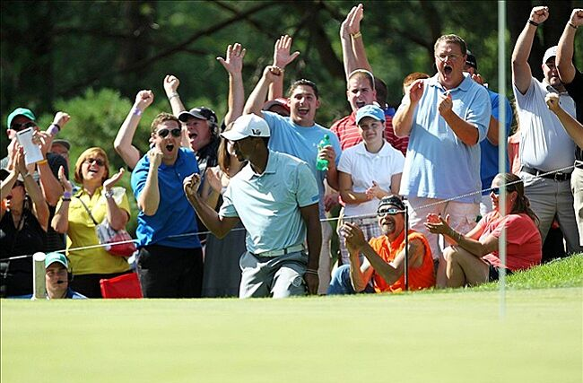Aug 3, 2013; Akron, OH, USA; Tiger Woods and the fans
