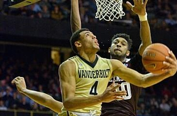 Feb 4, 2016; Nashville, TN, USA; Vanderbilt Commodores guard Wade Baldwin IV (4) drives to the basket against Texas A&M Aggies center Tonny Trocha-Morelos (10) during the second half at Memorial Gym. Vanderbilt won 77-60. Mandatory Credit: Jim Brown-USA TODAY Sports