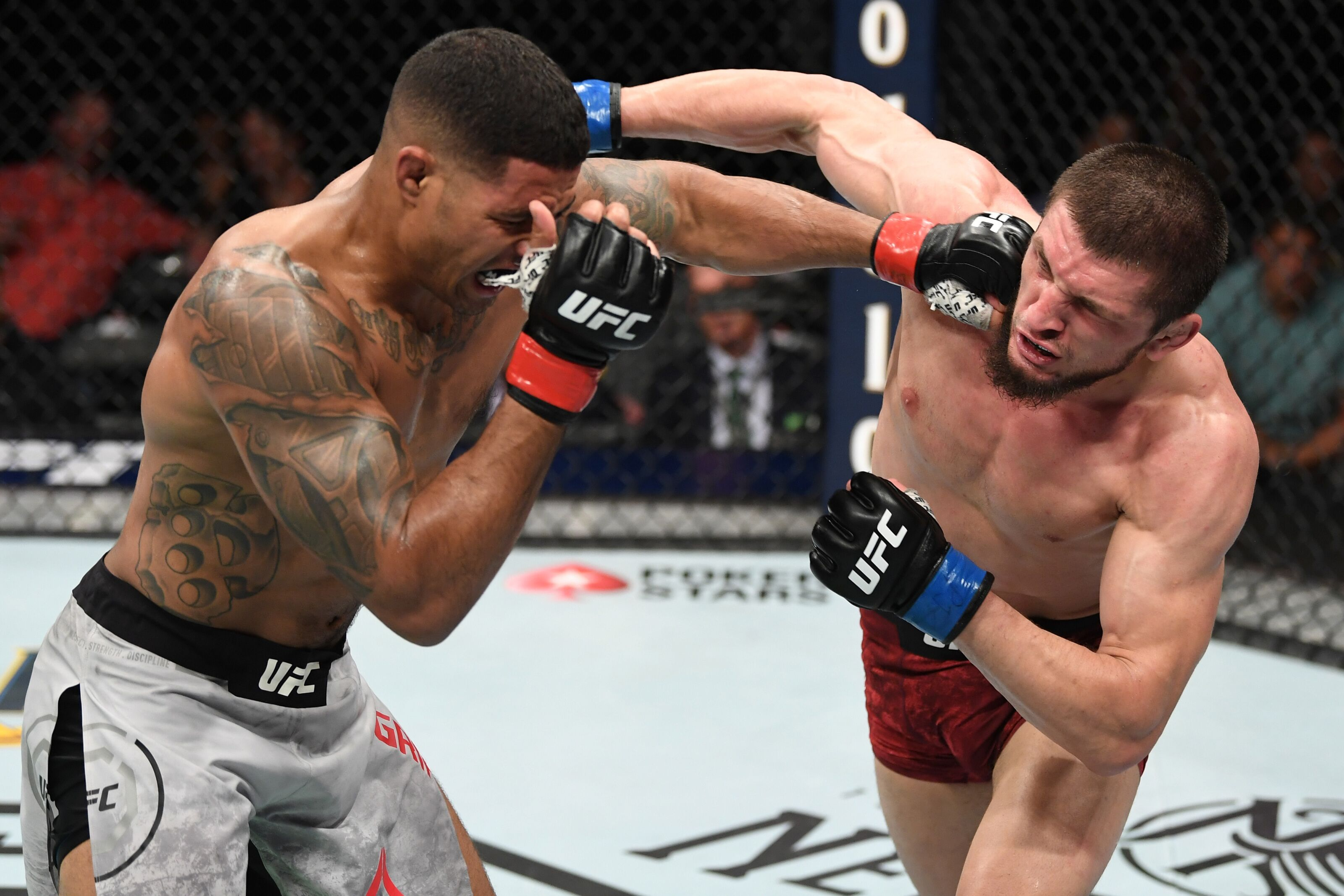 ATLANTA, GA - APRIL 13: (L-R) Max Griffin punches Zelim Imadaev of Russia in their welterweight bout during the UFC 236 event at State Farm Arena on April 13, 2019 in Atlanta, Georgia. (Photo by Josh Hedges/Zuffa LLC/Zuffa LLC via Getty Images)