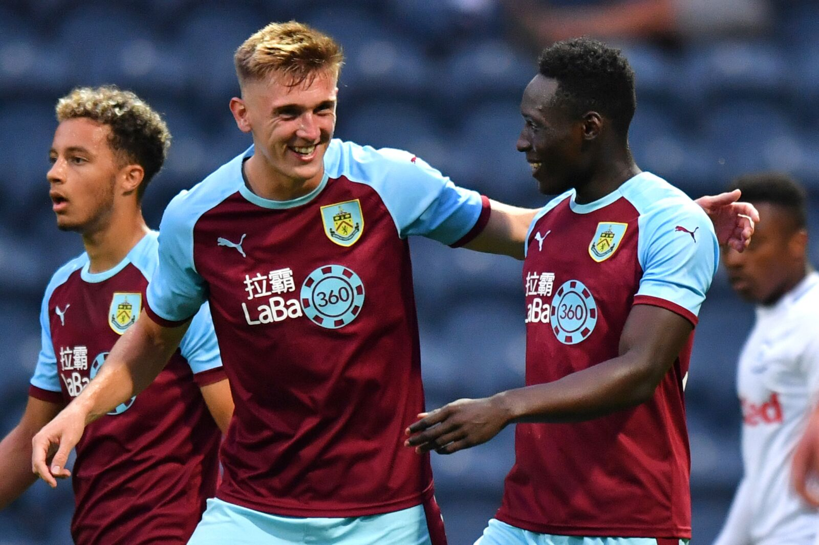 Burnley's Dan Agyei (right) celebrates scoring his side's first goal of the game with Burnley's Jimmy Dunne during a pre season friendly match at Deepdale, Preston. (Photo by Anthony Devlin/PA Images via Getty Images)