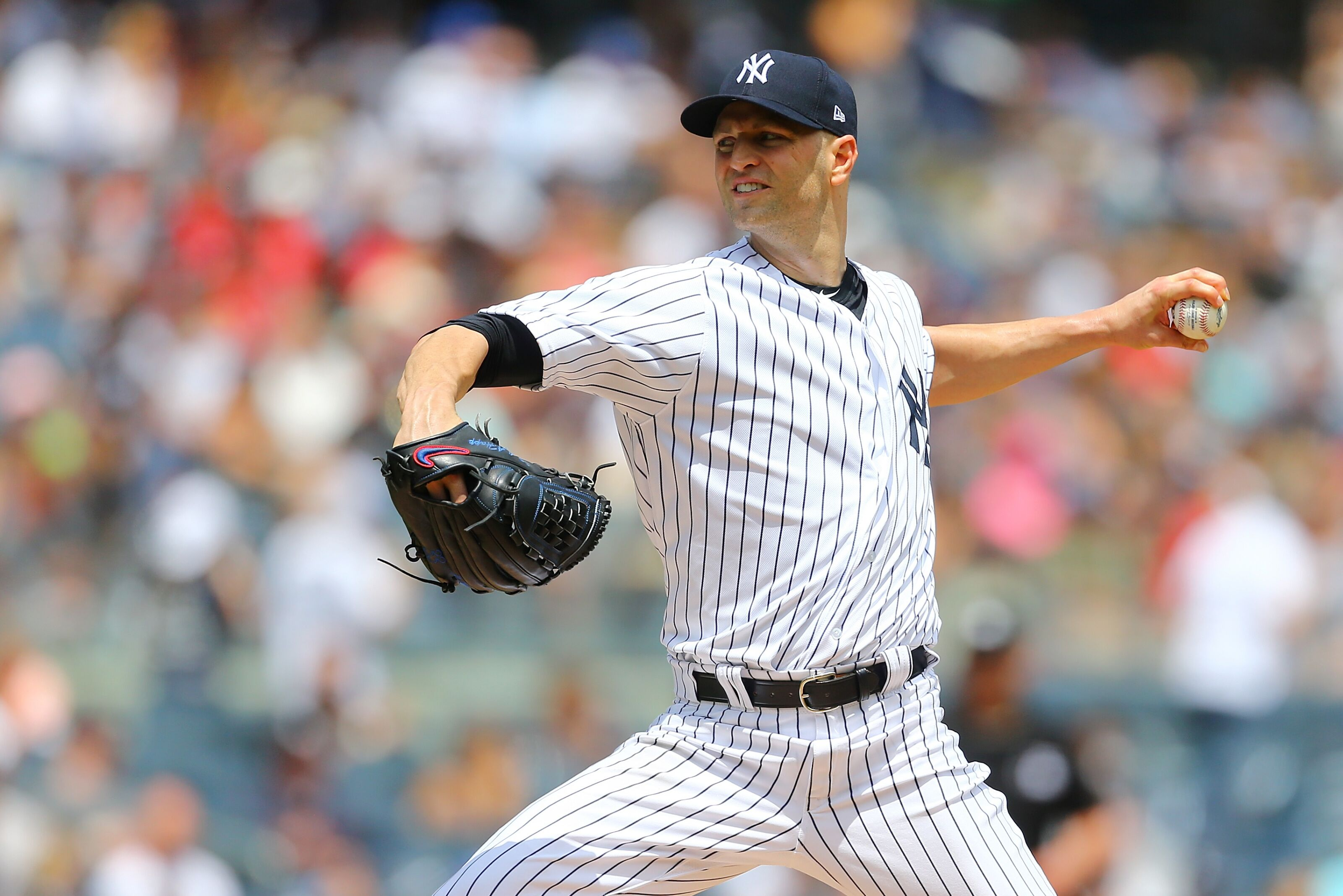NEW YORK, NY - JULY 29: J.A. Happ #34 of the New York Yankees pitches in the first inning against the Kansas City Royals at Yankee Stadium on July 29, 2018 in the Bronx borough of New York City. New York Yankees defeted the Kansas City Royals 6-3. (Photo by Mike Stobe/Getty Images)